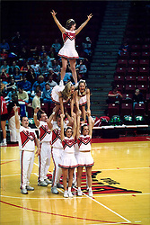 November 01, 2001:  Illinois State Redbirds Cheerleaders perform a pyramid cheering routine at half court during a basketball game...This image was scanned from a print.  Image quality may vary.  Dust and other unwanted artifacts may exist.