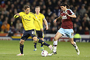 George Boyd of Burnley wins the ball off Gaston Ramirez of Middlesbrough during the Sky Bet Championship match between Burnley and Middlesbrough at Turf Moor, Burnley, England on 19 April 2016. Photo by Simon Brady.