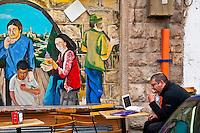 Israeli man eating lunch at a sidewalk restaurant, Jerusalem, Israel.