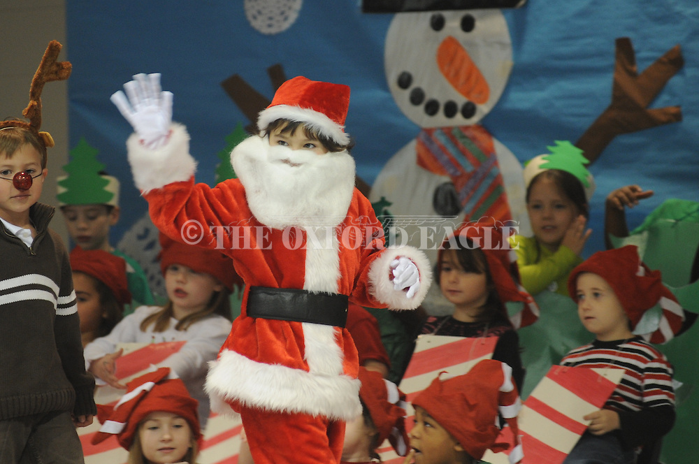 Nora Quong is Santa Claus as Lafayette Elmentary students perform Christmas on Candy Cane Lane, in Oxford, Miss. on Thursday, December 18, 2014. The play featured Christmas carols.