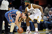 April 5, 2011; Cleveland, OH, USA; Charlotte Bobcats shooting guard Matt Carroll (33) runs into Cleveland Cavaliers point guard Baron Davis (85) during the fourth quarter at Quicken Loans Arena. The Cavaliers beat the Bobcats 99-89. Mandatory Credit: Jason Miller-US PRESSWIRE