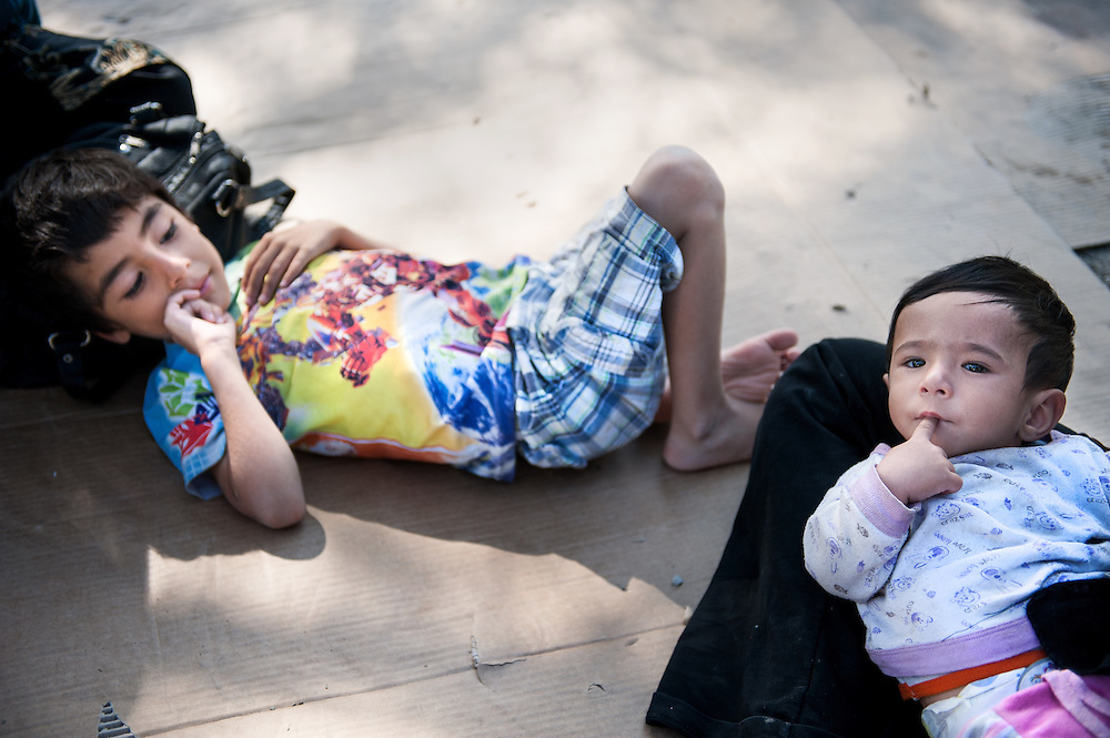 Nasrullah 6 years old  and his cousin Mohammed 1 year old from Afghanistan lying on a piece of cardboard in in Moria camp, Lesvos, Greece