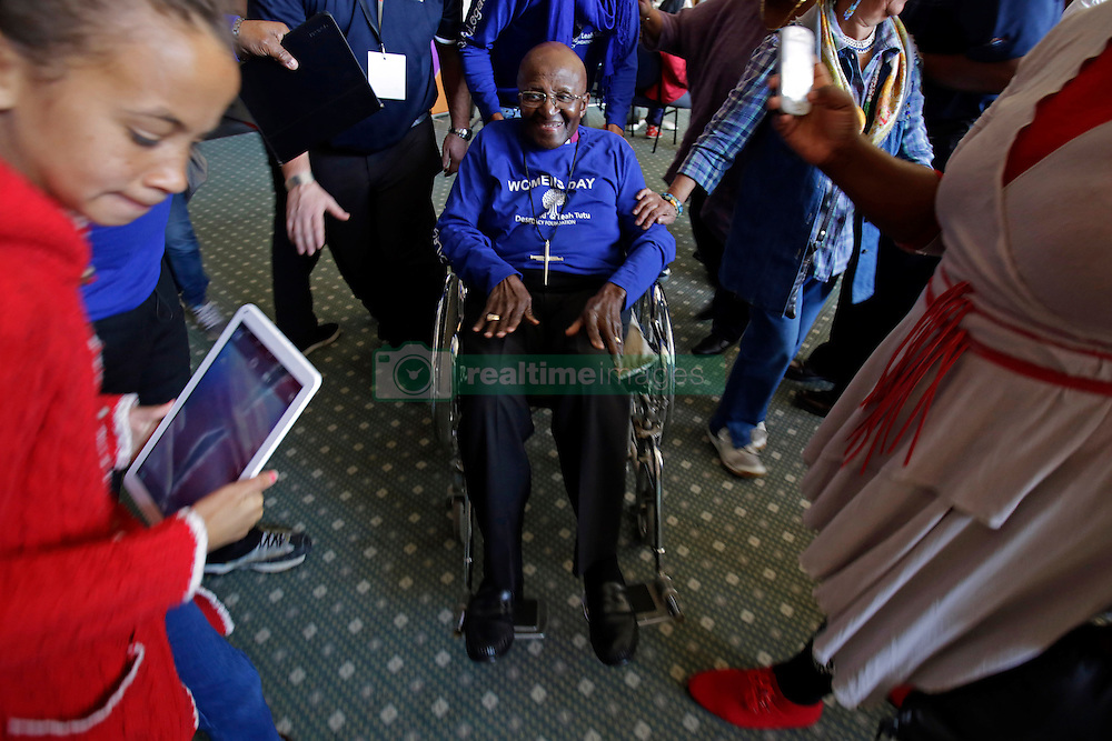 A frail looking but still delightful Archbishop Emeritus Desmond Tutu is pushed in a wheelchair during the annual Women's Day events that takes place yearly on Women's Day at Artscape Theatre Centre in Cape Town, South Africa. This event with Desmond Tutu and his wife Leigh took place shortly after the Women's Humanity Walk. This year's walk was an intergenerational celebration of the 60th anniversary of the 1956 Women's March where 20000 women marched on the Union Buildings in Pretoria, South Africa to protest for freedom and justice. Women from all walks of life and all religious and cultural backgrounds marched together in solidarity and in remembrance from the Slave Lodge to the Artscape Theatre in Cape Town, South Africa on the 9th August 2016.<br /> <br /> Photo by:   Mark Wessels / Real Time Images.