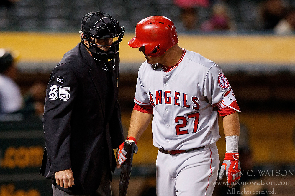 OAKLAND, CA - APRIL 04:  Mike Trout #27 of the Los Angeles Angels of Anaheim argues a called third strike with umpire Angel Hernandez #55 during the eighth inning against the Oakland Athletics at the Oakland Coliseum on April 4, 2017 in Oakland, California. The Los Angeles Angels of Anaheim defeated the Oakland Athletics 7-6. (Photo by Jason O. Watson/Getty Images) *** Local Caption *** Mike Trout; Angel Hernandez