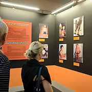 Visitors look at a panel of photographs of the effects of the use of Agent Orange during the Vietnam War on children born since. On display at the War Remnants Museum in Ho Chi Minh City (Saigon), Vietnam.