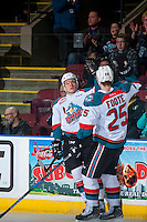 KELOWNA, CANADA - FEBRUARY 13: Calvin Thurkauf #27 and Cal Foote #25 of the Kelowna Rockets celebrate a first period goal against the Seattle Thunderbirds on February 13, 2017 at Prospera Place in Kelowna, British Columbia, Canada.  (Photo by Marissa Baecker/Shoot the Breeze)  *** Local Caption ***