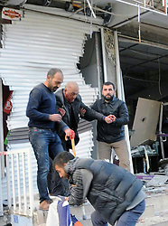 DIYARBAKIR, Nov. 4, 2016 (Xinhua) -- People help an injured man at the blast site in the city center of Diyarbakir, southeastern Turkey, Nov. 4, 2016. (Xinhua/Mert Macit) (yy) (Credit Image: © Mert Macit/Xinhua via ZUMA Wire)