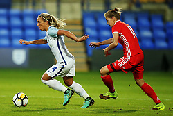 Nadezhda Smirnova of Russia chases Jordan Nobbs of England - Mandatory by-line: Matt McNulty/JMP - 19/09/2017 - FOOTBALL - Prenton Park - Birkenhead, United Kingdom - England v Russia - FIFA Women's World Cup Qualifier