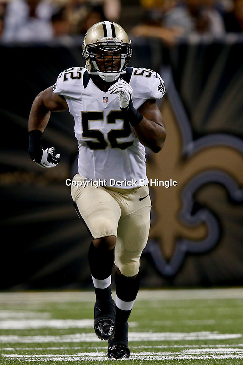 Aug 16, 2013; New Orleans, LA, USA; New Orleans Saints inside linebacker Kevin Reddick (52) against the Oakland Raiders during the second quarter of a preseason game at the Mercedes-Benz Superdome. Mandatory Credit: Derick E. Hingle-USA TODAY Sports