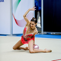 PADUA, ITALY - NOVEMBER 12 2016: Egizia Raliza Bergesio of Raffaello Motto performs with ball at the italian national rhythmic gymnastic championship. Her score in the apparatus is 16,000. Her team's score is 96,650 and ended up in fourth position.<br /> #SerieAdiritmica<br /> #ginnasticaritmica #rhythmicgymnastic #gymnast #sport #sportphotography