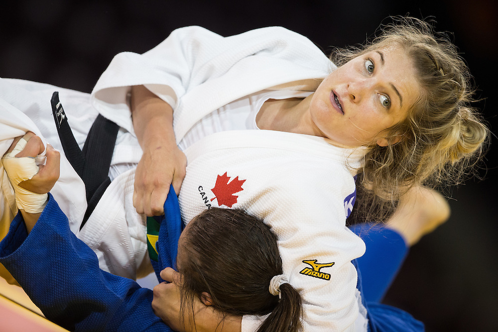 Kelita Zupancic (Top) of Canada pins Maria Portela to win the final of the table contest in the women's judo -70kg class at the 2015 Pan American Games in Toronto, Canada, July 13,  2015.  AFP PHOTO/GEOFF ROBINS