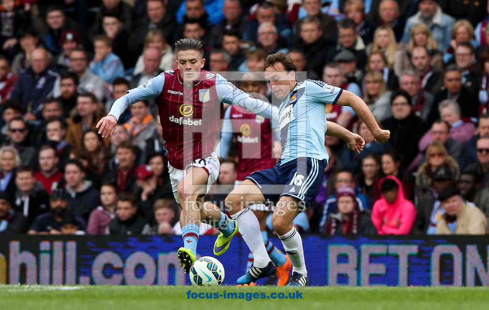 Jack Grealish (left) of Aston Villa puts Mark Noble (right) of West Ham United under pressure during the Barclays Premier League match at Villa Park, Birmingham<br /> Picture by Tom Smith/Focus Images Ltd 07545141164<br /> 09/05/2015