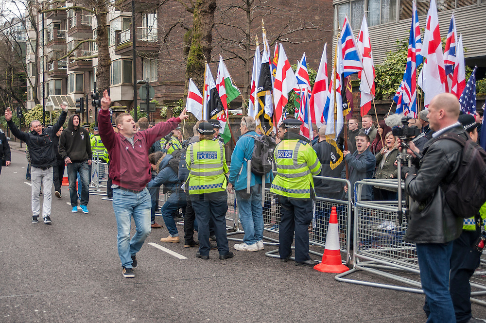 © Licensed to London News Pictures. 02/04/2015. Baker Street, London, UK. Members of the Britain First movement gather outside the London Central Mosque to protest against the Islamic Rally.  Photo credit : Stephen Chung/LNP