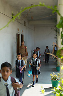 Students march back to class after morning assembly in the Vasudha Vidya Vihar school in Khargone, Madhya Pradesh, India on 12 November 2014. This school was built using the Fairtrade Premium funds of the Fairtrade cotton farmers and producers in Karhi village of Khargone. Photo by Suzanne Lee for Fairtrade