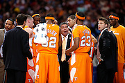 ST. LOUIS, MO - MARCH 26: Head coach Bruce Pearl of the Tennessee Volunteers talks to his team at a timeout in the game against the Ohio State Buckeyes during the Midwest regional semi-final of the NCAA men's basketball tournament at the Edward Jones Dome on March 26, 2010 in St. Louis, Missouri. Tennessee advanced with a 76-73 win. (Photo by Joe Robbins)