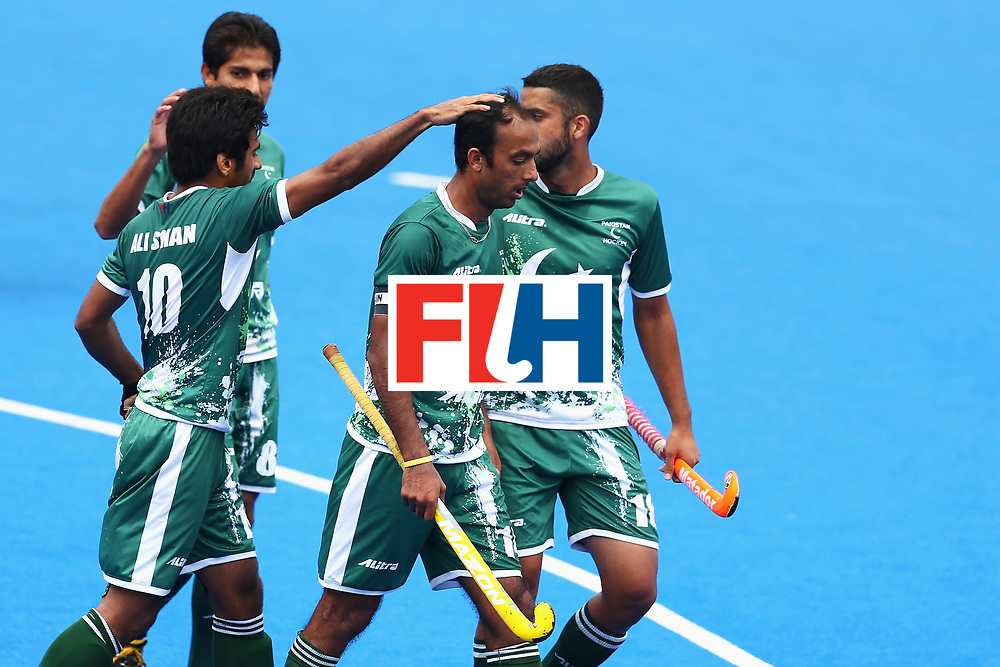 LONDON, ENGLAND - JUNE 25: Muhammad Umar Bhutta of Pakistan celebrates scoring his sides second goal with his Pakistan team mates during the 7th/8th place match between Pakistan and China on day nine of the Hero Hockey World League Semi-Final at Lee Valley Hockey and Tennis Centre on June 25, 2017 in London, England.  (Photo by Steve Bardens/Getty Images)