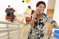 Businesswoman using mobile phone on stairs