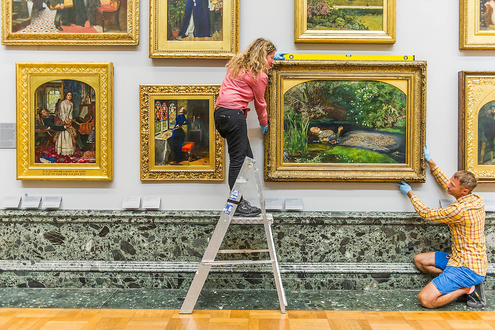 The return and re-hanging of the nation&rsquo;s Pre-Raphaelite works, including Millais&rsquo; Ophelia (pictured right), to Tate Britain. They are going back on display from Thursday 7 August 2014 after being seen by over 1.1 million people worldwide. They include: John Everett Millais&rsquo; , Ophelia; Beata Beatrix by Dante Gabriel Rossett (pictured left); The Lady of Shalott by John William Waterhouse; The Beloved by Rossetti; and Mariana (pictured centre) by John Everett Millais. These works are being displayed in the 'grand' surroundings of the 1840 galleries as part of the BP Walk through British Art. <br /> Millbank,  London, UK.