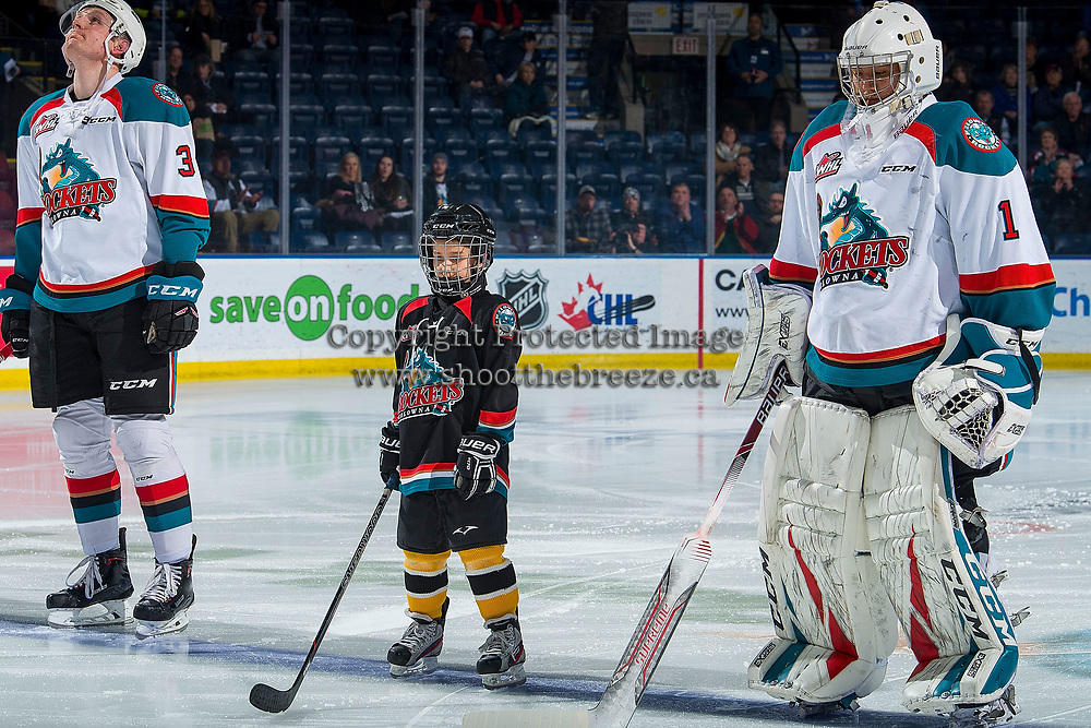 KELOWNA, CANADA - FEBRUARY 8:  The Pepsi player lines up on the blue line with Dalton Gally #3 and James Porter #1 of the Kelowna Rockets against the Prince George Cougars on February 8, 2019 at Prospera Place in Kelowna, British Columbia, Canada.  (Photo by Marissa Baecker/Shoot the Breeze)