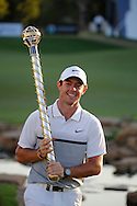 Rory McIlroy celebrates winning The DP World Tournaments with the trophy on the 4th day