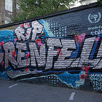 Grenfell graffiti art and the poster of missing person at Ladbroke Grove