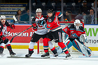 KELOWNA, BC - NOVEMBER 1: Roman Basran #30 defends the net as Elias Carmichael #14 of the Kelowna Rockets checks Connor Bowie #21 of the Prince George Cougars  at Prospera Place on November 1, 2019 in Kelowna, Canada. (Photo by Marissa Baecker/Shoot the Breeze)