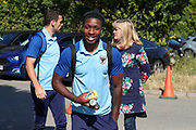 AFC Wimbledon attacker Michael Folivi (17) with a packet of pineapple and a can of red bull arriving for the game during the EFL Sky Bet League 1 match between AFC Wimbledon and Bristol Rovers at the Cherry Red Records Stadium, Kingston, England on 21 September 2019.