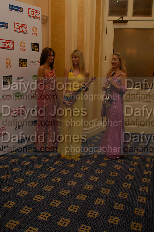 Classical music band, Bond. The Asian Business Awards 2005. Hilton. London. 7 April 2005. ONE TIME USE ONLY - DO NOT ARCHIVE  © Copyright Photograph by Dafydd Jones 66 Stockwell Park Rd. London SW9 0DA Tel 020 7733 0108 www.dafjones.com