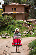 Quechua woman wearing traditional clothing and hat in Misminay Village, Sacred Valley, Peru.
