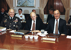 United States President George H.W. Bush, center, meets with his military advisors in the Pentagon Gold Room at the Pentagon in Washington, D.C., the usual meeting place of the Joint Chiefs of Staff, on August 15, 1990 to discuss the U.S. military response to the Iraqi invasion of Kuwait. From left to right: General H. Norman Schwarzkopf, U.S. Army, Commander-in-Chief U.S. Central Command; U.S. Secretary of Defense Dick Cheney; President Bush.<br /> Mandatory Credit: Robert D. Ward / DoD via CNP /ABACAPRESS.COM