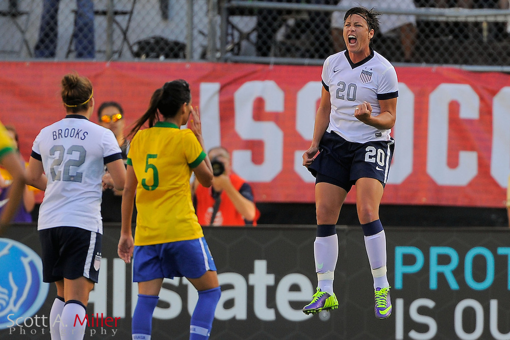 U.S. forward Abby Wambach (20) celebrates scoring on a penalty kick during the first half of  an international friendly against Brazil at the Florida Citrus Bowl on Nov. 10, 2013 in Orlando, Florida. <br /> <br /> <br /> <br /> &copy;2013 Scott A. Miller
