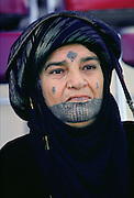 Woman with traditional tatooed markings on her face, Qatar