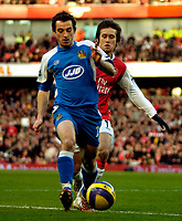 Photo: Ed Godden/Sportsbeat Images.<br /> Arsenal v Wigan Athletic. The Barclays Premiership. 11/02/2007. Wigan's Leighton Baines (L), clears the ball from the oncoming Tomas Rosicky.