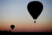 The dawn patrol balloonists are seen as the sun rises over Weld County near Frederick on Friday. Frederick in Flight runs Saturday June 25 and 26 and features a hot air balloon lift offs, live music, food vendors, a beer and wine garden, activities for kids and hot air balloons candle-sticking and glowing.<br /> Matthew Jonas/Staff Photographer June 24, 2016