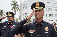 Miami Beach Police Major Paul Acosta who served from 1987 to 1991 in the Marine Corps and also is a combat veteran from the Gulf War salutes during a Memorial Day ceremony at the Miami Beach Police headquarters on Monday, May 28, 2018.