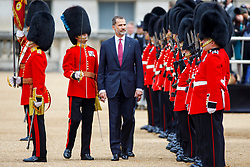 © Licensed to London News Pictures. 12/07/2017. London, UK. King Felipe VI of Spain inspects Ceremonial Guard of Honour on Horse Guards Parade in London on the first day of State visit of the King and Queen of Spain. Photo credit: Tolga Akmen/LNP