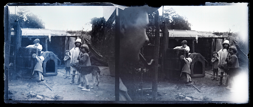 children playing at the doghouse in the backyard 1900s France