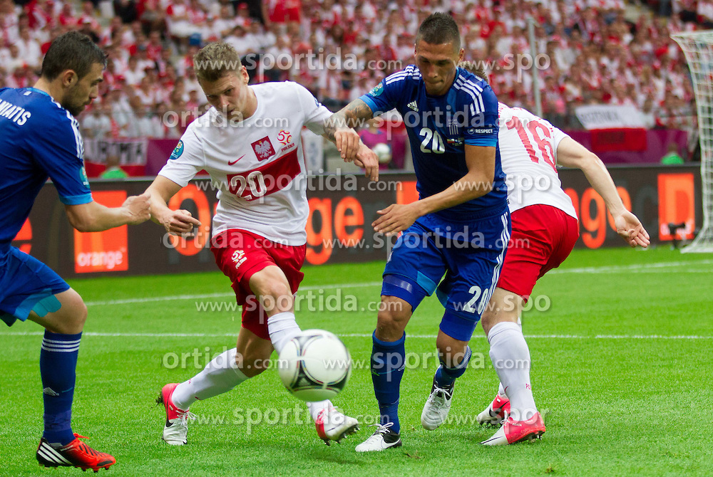 Lukasz Piszczek of Poland vs Jose Holebas  of Greece during the UEFA EURO 2012 group A match between Poland and Greece at The National Stadium on June 8, 2012 in Warsaw, Poland.  (Photo by Vid Ponikvar / Sportida.com)
