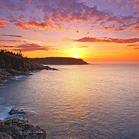 Acadia Magic &ndash; Sunrise Maine Acadia National Park coastal photography images are available as museum quality photography prints, canvas prints, acrylic prints or metal prints. Prints may be framed and matted to the individual liking and room decor needs:<br /> <br /> http://juergen-roth.pixels.com/featured/acadia-magic-juergen-roth.html<br /> <br /> Stunning sunrise seacoast photography showing a spectacular vista across the beautiful cliffs of the Maine rocky coastal shoreline in Acadia National Park. <br /> Acadia NP is a National Park located in the U.S. state of Maine. It reserves much of Mount Desert Island, and associated smaller islands, off the Atlantic coast. The park is one of the most visited wildlife areas in the United States and a paradise for every photographer and outdoor enthusiast. The park loop road provides easy access to many of the iconic photography subjects, such as Monument Cove, Sand Beach, Jordan Pond and the Bubbles, Otter Cliff to name only a few. The carriage roads and hiking trails provide further access to more remote locations where the park continues to inspire and unfolds its full magic. It is a heaven for macro, seascape, and landscape photography that makes for great wall art decoration. Especially sunrise and the light of the golden hours paint the sky in beautiful blue and orange and bring out the beauty of the pink granite rocks.<br /> <br /> Good light and happy photo making! <br /> <br /> My best, <br /> <br /> Juergen <br /> Website: www.RothGalleries.com<br /> Twitter: @NatureFineArt<br /> Facebook: https://www.facebook.com/naturefineart<br /> Instagram: https://www.instagram.com/rothgalleries