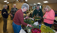 Beverly Clarenbach, Eleaner Swain and Eileen Russilillo make centerpieces for the Opechee Garden Club at Weirs Community Center on Tuesday.  (Karen Bobotas/for the Laconia Daily Sun)