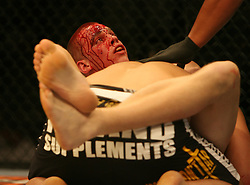 A bloody and battered Stefan Struve of the Netherlands(L) battles with Dennis Stojnic  (BOS HERZ). Cologne, Germany,  Ultimate Fighting Championship.