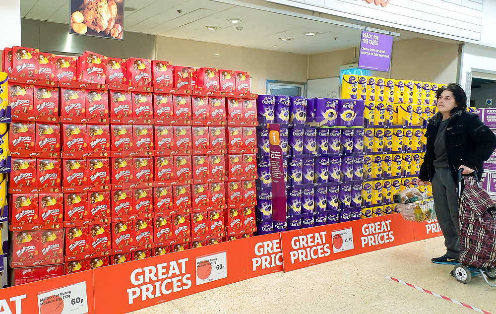 © Licensed to London News Pictures. 20/04/2020. London, UK. A shopper looks at a large selection of unsold Easter Eggs at Sainsbury's supermarket in north London, a week after Easter weekend. Sainsbury's has reduced the price of Easter Eggs to clear the stock.<br /> The government had ordered people to 'Stay home this Easter' during coronavirus lockdown to slow the spread of COVID-19 and reduce pressure on the NHS. Photo credit: Dinendra Haria/LNP