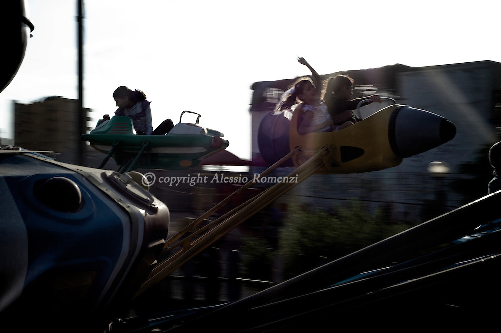 Palestinians enjoy a ride at the Sinbad amusement park in the northern Gaza Strip town of Beit Lahia, near Gaza City, during the first day of the Eid al-Fitr holiday which marks the end of the Muslim fasting month of Ramadan on September 10, 2010.© ALESSIO ROMENZI