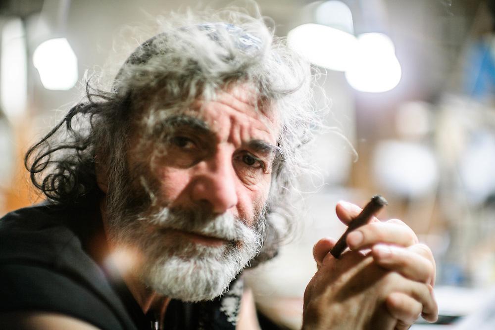 02 FEB 2011 - Erto (Pordenone) - Mauro Corona, scrittore, alpinista e scultore, nel suo studio :-: Italian writer, climber and carver Mauro Corona at his place