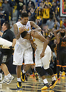 Dec 19, 2013; Long Beach, CA, USA; Long Beach State guards Tyler Lamb (1) and Mike Caffey (5) celebrate after the game against the Southern California Trojans at Walter Pyramid. Long Beach State defeated USC 72-71.