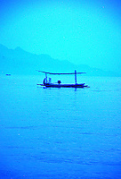 Remarkable color of a blue boat on a blue sea, Bali, Indonesia.