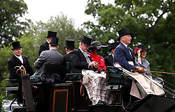 Racegoers arrive by horse and carriage during day one of Royal Ascot at Ascot Racecourse.