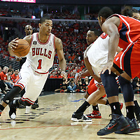 10 May 2011: Chicago Bulls point guard Derrick Rose (1) drives past Atlanta Hawks guard Jeff Teague (0) on a screen set by Chicago Bulls center Joakim Noah (13) during the Chicago Bulls 95-83 victory over the Atlanta Hawks, during game 5 of the Eastern Conference semi finals at the United Center, Chicago, Illinois, USA.