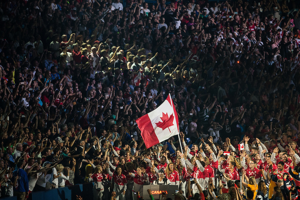 The Canadian team enters the stadium during the opening ceremonies at the 2015 Pan American Games in Toronto, Canada, July 10,  2015.  AFP PHOTO/GEOFF ROBINS