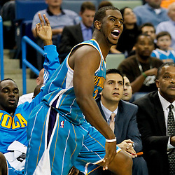 October 13, 2010; New Orleans, LA, USA; New Orleans Hornets point guard Chris Paul (3) reacts following a shot during the second quarter of a preseason game against the Miami Heat at the New Orleans Arena. Mandatory Credit: Derick E. Hingle